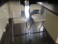 2 white bar stools