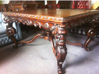 Heavily carved walnut dining table