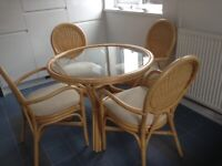 Good quality cane table and chairs suitable for a conservatory. New lower price.