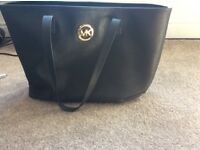 Michael Kors black tote handbag, this has been used a handful of times it is real and good condition
