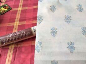 17 rolls of unopened Crown wallpaper with fleur de Lys patter in blue .