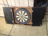 Dartboard in a wall cabinet some dust from storage £12.