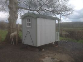 Children's shepherds hut with bed and kitchen.
