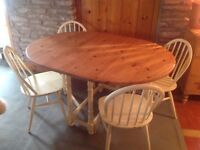 Sturdy pine kitchen table and four chairs
