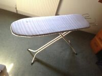 Ironing board with cover and attached iron stand