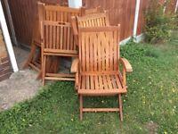 Six hardwood garden chairs with cushions
