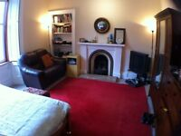 Very large Double bedroom Centrally located for the Festival available now.