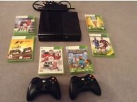 Xbox 360 Slim Console with 6 games and 2 remotes