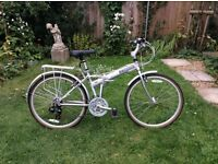 Hibrid fold up bike excellent condition. Make: Dahon
