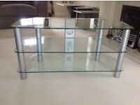 Clear glass TV stand. Three shelves and cable management. Used but as new condition.