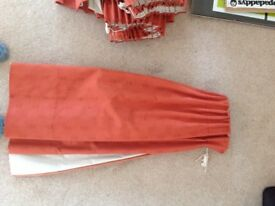 2 pairs of terracotta coloured curtains, heavy fabric with very heavy blackout thermal linings.