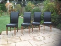 4 dining chairs by Willis and Gambler in black faux leather
