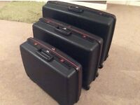 Set of 3 Delsey Rigid Suitcases, 2 with wheels and grab handles