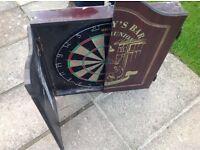 Dart board in wooden case