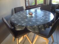 Beautiful brand new and still in box solid oak and glass dining table