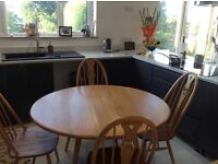 Ercol solid elm and beech drop leaf dining table and 4 swan design chairs