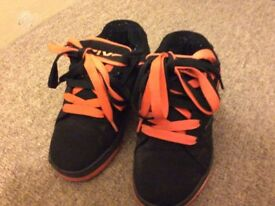 Heelys: black and orange, size 2, 1 wheel on each shoe, worn but in good condition.