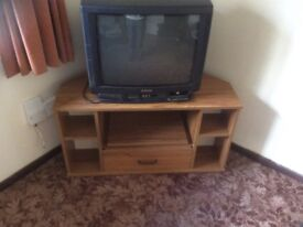 TV corner unit with slide out shelf and drawer.
