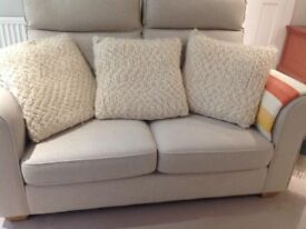 Three cuddly Habitat cream wool cushions