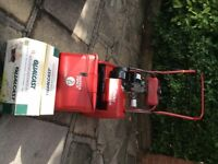 Petrol Suffolk Punch 14s Lawnmower with scarifier cassette