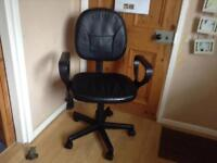 Leather look computer chair good condition with arm rest goes up & down