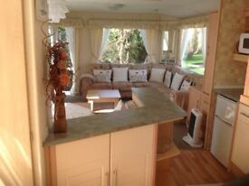 Large 12x35ft, 2 bedroom caravan for sale including large decking