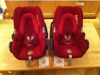 Two Maxi-cosi CabrioFix car seats, group 0+, in robin red, in excellent condition