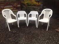 4 White plastic garden chairs in good condition.