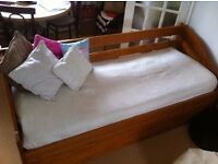 Daybed (single) with hideaway guest bed. Guest mattress on wheeled base underneath.