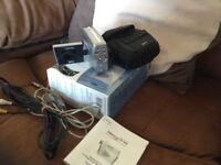 Pocket digital still camera and video