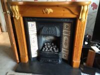 Antique pine fire surround,includes gas fire.