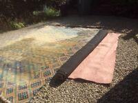 Rug (multicoloured) and underlay pad