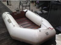 Inflatable dinghy and engine