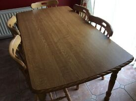 Dining table in good condition with a heat resistant top and 6 chairs