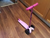 Pink micro scooter used by in good conditions