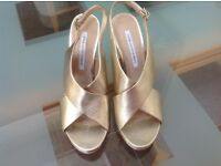 Designer gold leather shoes/sandals size5
