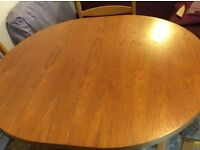 Teak effect dining table and four chairs