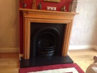 Victorian cast iron fire insert. With fire surround and slate hearth