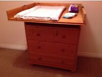 Baby changer unit; three large drawers and shelf.