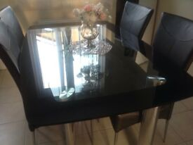 Black glass table with 6 faux leather chairs