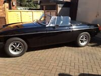 MGB ROADSTER. BLACK. EXCELLENT CONDITION. RUNS VERY WELL. 47000 MILES