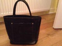 Osprey black leather handbag.