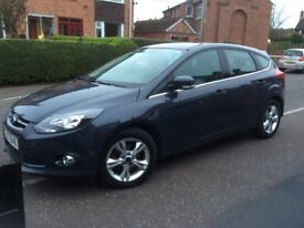 2012 Grey Ford Focus. In very good condition.