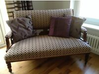 ANTIQUE 2 SEATER SOFA WITH INTRICATE WOODEN CARVING AND ARMCHAIR