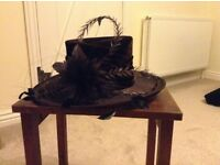 Ladies formal chocolate brown hat with feather detail