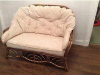 Two seater conservatory cane sofa