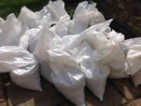 60 bags of Hard Core approx 1.5 tonne (1500 kg) of mixed 200 ml hardcore and golden Flint chips