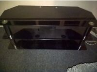 glass and chrome tv unit, coffee table and 2 other small tables.