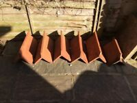Red crested clay ridge tiles