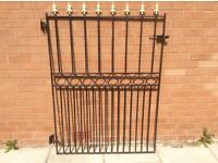 Heavy wrought iron gate . 64 inches high by 44 inches wide . Free .